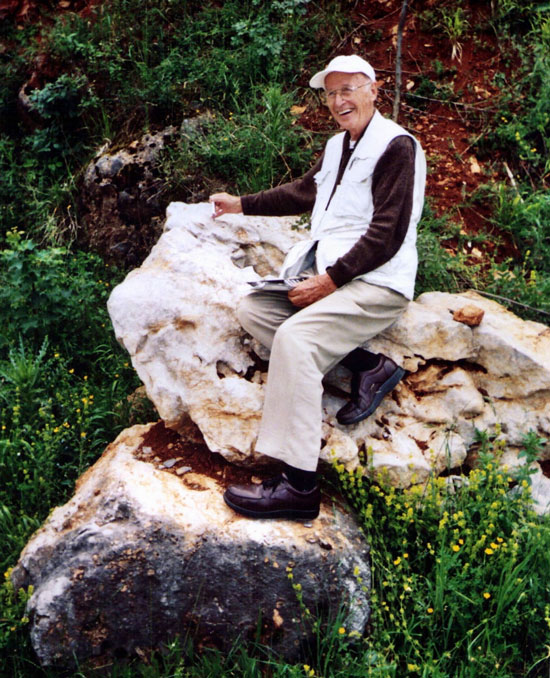 Founder of PELA, Dr. Philip E. LaMoreaux, sitting atop a limestone structure